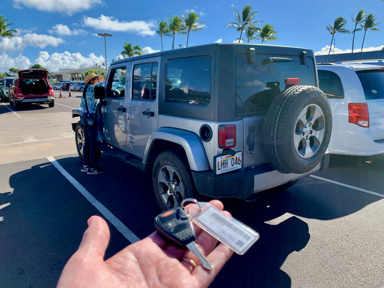 Customer at car rental lot with a key
