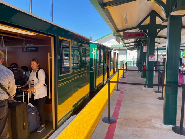 Visitors inside the Maui airport trolley