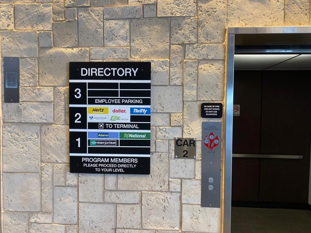 Car rental directory at the elevator
